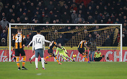 Hull City's Tom Huddlestone scores his sides opening goal from the penalty spot during the EFL Cup Semi Final, Second Leg match at the KCOM Stadium, Hull.