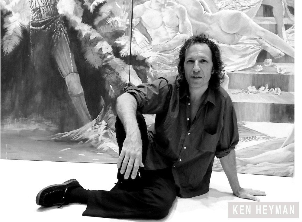 Adam Cvijanovic in front of his large scale painting, fifty feet long by twenty feet high.