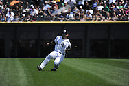 CHICAGO - JULY 06:  Carlos Quentin #20 of Chicago White Sox makes makes a sliding catch of a ball hit by Billy Butler #16 of the Kansas City Royals on July 6, 2011 at U.S. Cellular Field in Chicago, Illinois.  The Royals defeated the White Sox 4-1.  (Photo by Ron Vesely)  Subject: Carlos Quentin;Billy Butler