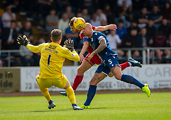 Dundee's keeper Jack Hamilton, Ayr United's Ross Docherty, Dundee's Jordan forester. Half time : Dundee 0 v 0 Ayr United, Scottish Championship game played 10/8/2019.