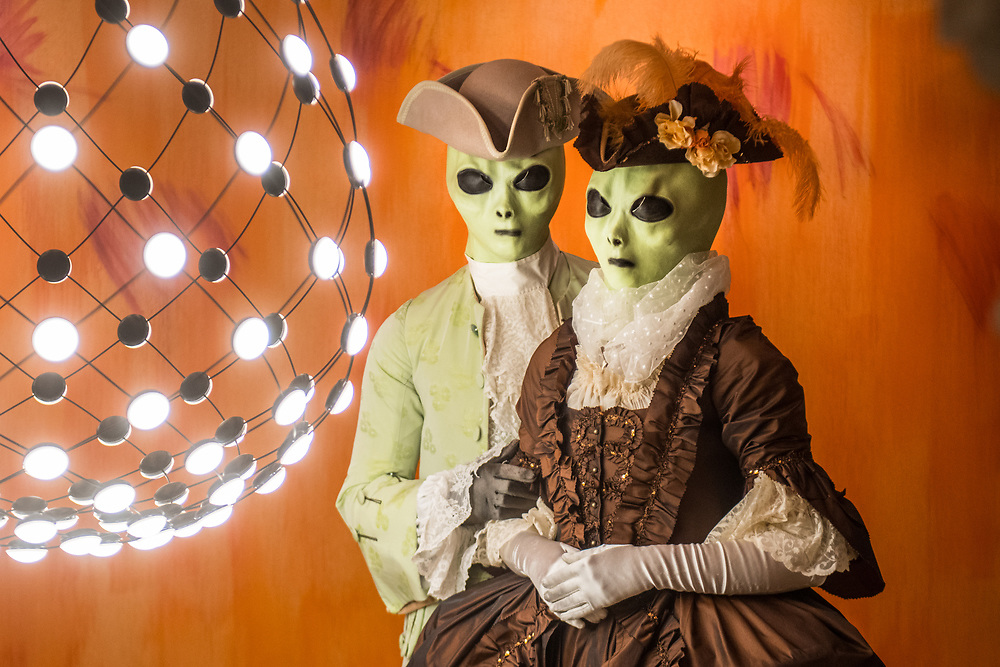Venice, February 2019<br /> Models wear a dress' 700 man light green, that was chosen to be philological in the material and model, and a dress' 700 woman brown, made entirely of Rubelli silk cut alive, both wearing alien masks.<br /> The theme for the 2019 edition of Venice Carnival is 'Venice, the oldest city of the future!' and will run from 16th of February to 5th of March 2019.