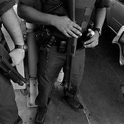 U.S. Customs and Border Patrol Officers search vehicles at the Laredo port of entry coming into Texas from Mexico..(Credit Image: © Louie Palu/ZUMA Press).June 2012