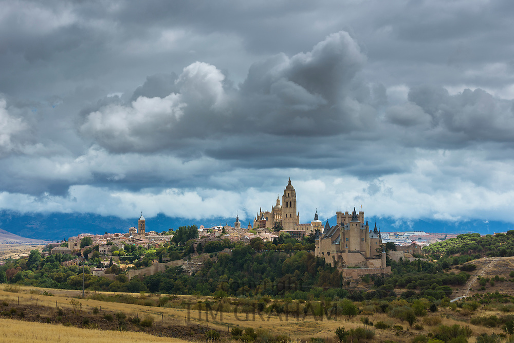 Famous view of Alcazar Castle - palace and fortress which inspired Disney castle, and Cathedral, Segovia, Spain
