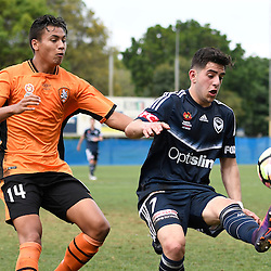 BRISBANE, AUSTRALIA - NOVEMBER 12: Christian Theoharous of the Victory controls the ball under pressure from Dane Ingham of the Roar during the round 1 Foxtel National Youth League match between the Brisbane Roar and Melbourne Victory at Spencer Park on November 12, 2016 in Brisbane, Australia. (Photo by Patrick Kearney/Brisbane Roar)