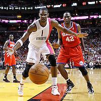 21 January 2012: Miami Heat power forward Chris Bosh (1) and Philadelphia Sixers power forward Elton Brand (42) eyes the loose ball during the Miami Heat 113-92 victory over the Philadelphia Sixers at the AmericanAirlines Arena, Miami, Florida, USA.