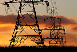File photo dated 24/11/10 of electricity pylons. A 2040 ban on conventional petrol and diesel cars and vans would push up UK electricity demand by less than 10\% by mid-century, analysis shows.