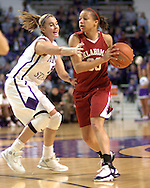 Oklahoma guard Britney Brown (R) looks to make a pass against pressure from Kansas State's Shalee Lehning (L), during the first half at Bramlage Coliseum in Manhattan, Kansas, February 21, 2006.  The 9th ranked Sooners defeated K-State 78-64.