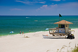 lifeguard huts with rescue boat and dune buggy, note stakes with yellow tags marking turtle nests, Juno Beach, one of the most productive sea turtle nesting sites in the world, Florida, Atlantic Ocean
