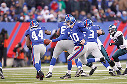 New York Giants quarterback Eli Manning #10 hands the ball off during the NFL Game between the Philadelphia Eagles and the New York Giants.  The Eagles won 38-31 at The New Meadowlands Stadium in East Rutherford, New Jersey on Sunday December 19th 2010. (Photo By Brian Garfinkel)