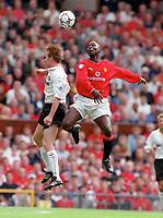 Andy Cole (Man Utd) jumps with Jody Craddock (Sunderland). Manchester United v Sunderland. FA Premiership, 9/9/00. Credit Colorsport / Nick Kidd.