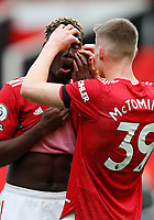 Football - 2020 / 2021 Premier League - Manchester United vs Burnley - Old Trafford<br /> <br /> Scott McTominay of Manchester United helps Paul Pogba with his contact lens at Old Trafford<br /> <br /> Credit COLORSPORT/LYNNE CAMERON