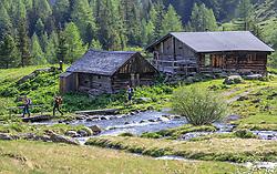 THEMENBILD - drei Wanderer wandern an der Neualm in den Schladminger Tauern vorbei, aufgenommen am 4. Juni 2017 in Schladming, Österreich // three hikers on a path near the Neualm on 2017/06/04, Schladming, Austria. EXPA Pictures © 2017, PhotoCredit: EXPA/ Martin Huber