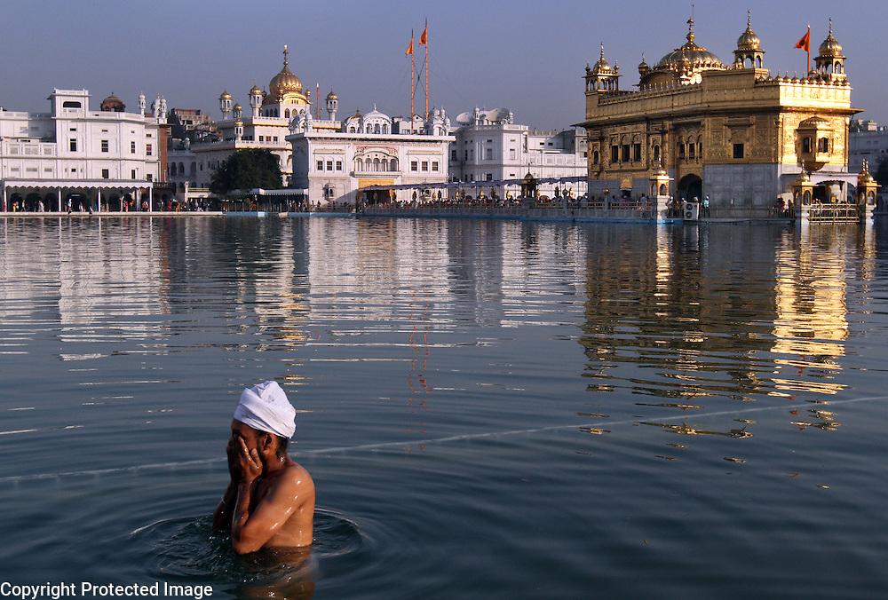 A Sikh baths at the Golden Temple in Amritsar, India.<br /> Photo by Shmuel Thaler <br /> shmuel_thaler@yahoo.com www.shmuelthaler.com