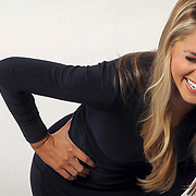 ESPN's Laura Rutledge laughs it up during a photo shoot in Charlotte.  ©Travis Bell Photography