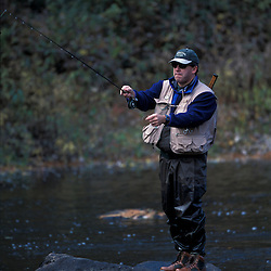 A fly-fisherman on the Lamprey River below Wiswall Dam.Durham, NH