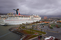 """(Image two of nine) Panorama of the Ensenada harbor in Mexico on a grey and raining day from the deck of the MV World Odyssey. The other cruse ship is the Carnival Imagination. Once all of the students, faculty, staff, and life long learners were aboard we would be ready to begin the 102 day """"round the world"""" Semester at Sea Spring 2016 Voyage. Composite of nine images taken with a Leica T camera and 23 mm f/2 lens (ISO 250, 23 mm, f/2, 1/80 sec). Panorama stitched using AutoPano Giga Pro."""