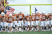 AUSTIN, TX - AUGUST 31: The Texas Longhorns take the field before kickoff against the New Mexico State Aggies on August 31, 2013 at Darrell K Royal-Texas Memorial Stadium in Austin, Texas.  (Photo by Cooper Neill/Getty Images) *** Local Caption ***