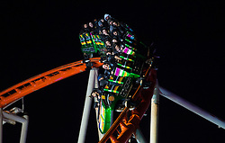 Visitors enjoy a rollercoaster at Hyde Park Winter Wonderland in London.