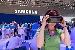 Samsung Virtual Reality (VR) headset being demonstrated to visitor at 2016  IFA (Internationale Funkausstellung Berlin), Berlin, Germany