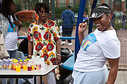 Volunteer Debbie dancing to the music at the Pathways Project launch by Souther Housing Group, Stamford Hill Estate London. The pathways project is a voluntary information, support and guidance service aimed at young people aged 16-25 years in Hackney.
