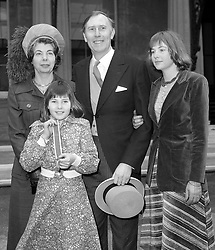 File photo dated 04-02-1975 of Sir Roger Bannister, who was the first athlete to break the four minute mile barrier, leaving Buckingham Palace with his wife Moyra and daughters Erin, 17, and Charlotte, 11, after being knighted by the Queen.