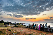 Pilgrims on the beach at Kanyakumari, Tamil Nadu, Southern India at sunset