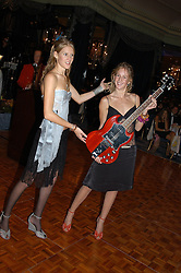Left to right, sisters ANNA BOGLIONE and LARA BOGLIONE at the Chain of Hope Autumn Ball Fiesta held at The Dorchester, Park Lane, London on 6th October 2004.