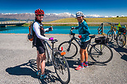 Cyclists riding the Tekapo Canal on the REI Adventures Cycle New Zealand trip