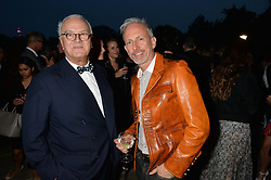 Left to right, MANOLO BLAHNIK and PATRICK COX at a party hosed by the US Ambassador to the UK Matthew Barzun, his wife Brooke Barzun and editor of UK Vogue Alexandra Shulman in association with J Crew to celebrate London Fashion Week held at Winfield House, Regent's Park, London on 16th September 2014.