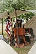 USA, Oregon, Brooks, Willamette Mission State Park, Union Cavalry Civil War reenactors rest in camp before the battle.