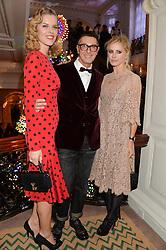 Left to right, EVA HERZIGOVA, STEFANO GABBANA and LAURA BAILEY at the Claridge's Christmas Tree By Dolce & Gabbana Launch Party held at Claridge's, Brook Street, London on 26th November 2013.