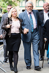 © Licensed to London News Pictures. 02/06/2014. London, UK. Artist and television personality, Rolf Harris arrives at Southwark Crown Court in London on 2nd June 2014 with his daughter Bindi Harris. Rolf Harris denies 12 counts of indecent assault against four girls and women between 1968 and 1986. Photo credit : Vickie Flores/LNP