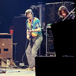 Phil Lesh performing with the Grateful Dead in Concert at the Brendan Bryne Arena on April 1st 1988. Side view from stage left. Bob Weir partly obsured to the right.