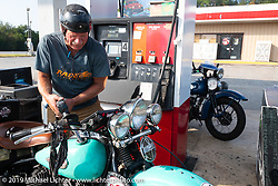Bruce Redpath filling up his 1947 Harley-Davidson model U during the Cross Country Chase motorcycle endurance run from Sault Sainte Marie, MI to Key West, FL. (for vintage bikes from 1930-1948). Stage-7 covered 249 miles from Macon, GA to Tallahassee, FL USA. Thursday, September 12, 2019. Photography ©2019 Michael Lichter.