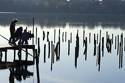 Workers installing a boat and fishing dock on a lake in Minnesota