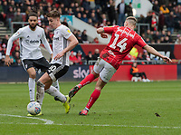 Fulham's Tom Cairney (centre) under pressure from Bristol City's Andreas Weimann (right) <br /> <br /> Photographer David Horton/CameraSport<br /> <br /> The EFL Sky Bet Championship - Bristol City v Fulham - Saturday 7th March 2020 - Ashton Gate Stadium - Bristol<br /> <br /> World Copyright © 2020 CameraSport. All rights reserved. 43 Linden Ave. Countesthorpe. Leicester. England. LE8 5PG - Tel: +44 (0) 116 277 4147 - admin@camerasport.com - www.camerasport.com