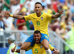 Brazil's Neymar (centre) celebrates scoring his side's first goal of the game