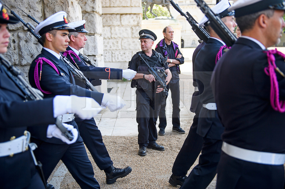 © Licensed to London News Pictures. 16/07/2016. London, UK. Armed police watch over a parade on Horseguards Parade in Westminster, London two days after more than 80 people were killed in a terrorist attack in Nice, southern France. Photo credit: Ben Cawthra/LNP