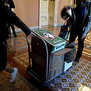 Staffers move boxes from HVC-304, the room used for the House Intelligence Committee, to the Senate Chamber prior to opening arguments in the impeachment trial against President Trump on Tuesday, January 21, 2020.
