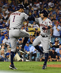 October 25, 2017 - Los Angeles, California, U.S. - Houston Astros' Jose Altuve (27) celebrates with teammate Carlos Correa (1) after hitting a solo home run against the Los Angeles Dodgers in the tenth inning of game two of a World Series baseball game at Dodger Stadium on Wednesday, Oct. 25, 2017 in Los Angeles. Houston Astros won 7-6 in 11 innings. (Photo by Keith Birmingham, Pasadena Star-News/SCNG) (Credit Image: © San Gabriel Valley Tribune via ZUMA Wire)
