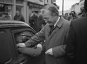 Image of Fianna Fáil leader Charles Haughey touring West Cork during his 1982 election campaign...04/02/1982.02/04/82.4th February 1982..Back patting:..Charles Haughey patting the back of a motorist on his campaign trail.