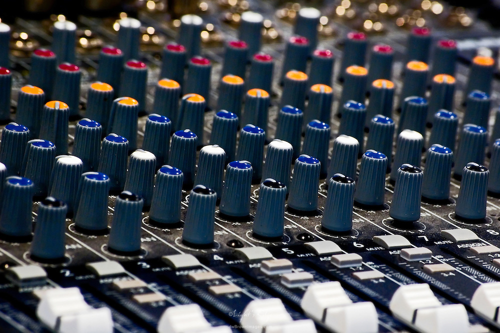 A soundboard sits ready to work its magic while one knob rises above the rest.