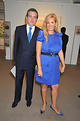 CHRISTOS ZAMPOUNIS and ELENA MAKRI LIBERIS at a party to celebrate the publication of Elena Makri Liberis's book 'Every Month, Same day' held at Sotheby's, 34-35 New Bond Street, London on 5th May 2009.