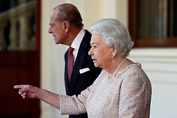 Queen Elizabeth II and the Duke of Edinburgh bid farewell to Colombia's President Juan Manuel Santos and his wife Maria Clemencia de Santos following their state visit, at Buckingham Palace in London.