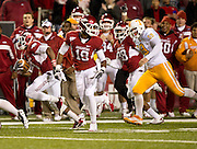 Nov 12, 2011; Fayetteville, AR, USA;  Arkansas Razorback running back Dennis Johnson (33) makes a punt return as wide receiver Javontee Herndon (19) and cornerback Jerry Mitchell (38) block and Tennessee Volunteers Nick Guess (59) looks on during the first half at Donald W. Reynolds Razorback Stadium. Mandatory Credit: Beth Hall-US PRESSWIRE