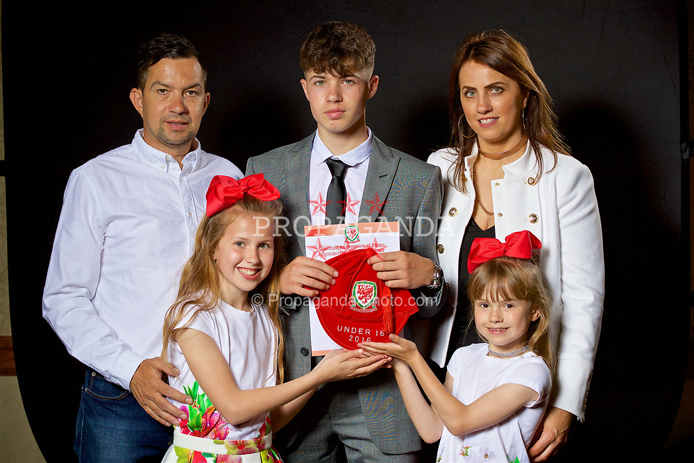 NEWPORT, WALES - Saturday, May 27, 2017: Neco Williams and family with his Under-16 Wales cap at the Celtic Manor Resort. (Pic by David Rawcliffe/Propaganda)