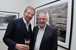 Left to right, HUGO BURNAND and JULIAN CALDER at a private view of photographs by wildlife photographer David Yarrow included in his book 'Encounter' held at The Saatchi Gallery, Duke of York's HQ, King's Road, London on 13th November 2013.