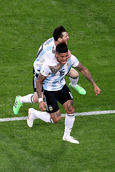 Argentina's Marcos Rojo (front) celebrates scoring his side's second goal of the game with team-mate Lionel Messi (back) during the FIFA World Cup Group D match at Saint Petersburg Stadium.