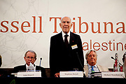 "London session of the Russel Tribunal on Palestine. "" Corporate Complicity in Israel's violations in international human rights law and international humanitarian law"".  John Dugard,left, Stephane Hessel and Michael Mansfield QC. Stephane Hessel is opening the tribunal."