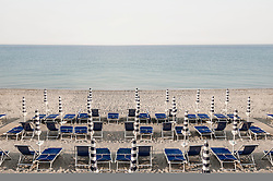 Beach Italy summer morning deck chair empty